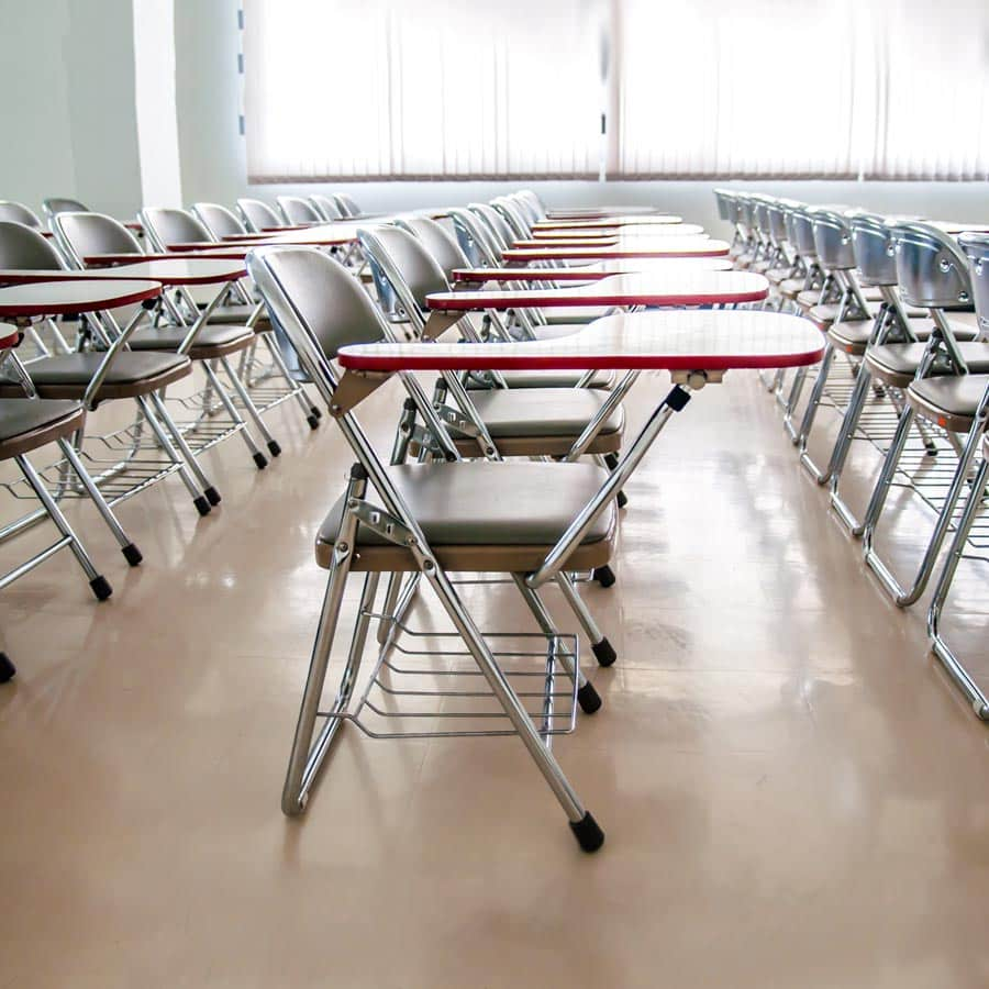empty chairs in classroom depicting online registration with school software